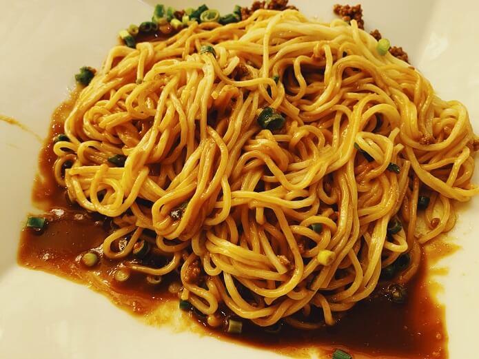 赤坂四川飯店の正宗担々麺(汁無し)を混ぜ込んだところ